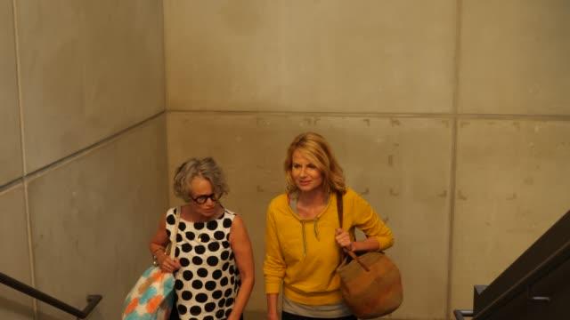 Mature women climbing stairs of dance studio