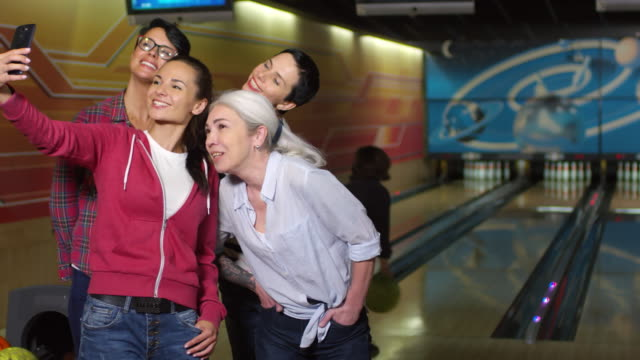 Mature Women Taking Selfie at Bowling Alley