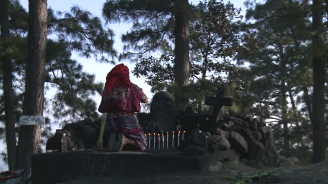 Mayan priest prays in temple ruins video