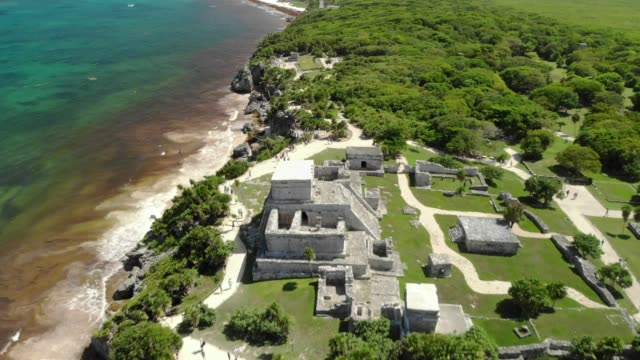 Mayan Ruins at Tulum, Mexico Aerial view of Mayan Ruins at Tulum, Quintana Roo, Mexico. Ruins of a walled, ancient Mayan city, located on a bluff overlooking the Caribbean Sea. Pyramid El Castillo (The Castle), Temple of the Frescoes old ruin stock videos & royalty-free footage
