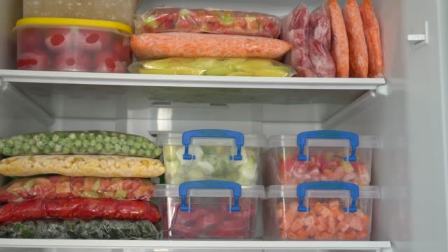 Meal Prep. Freezer Organization To Blanch And Preserve (Freeze) Fresh Vegetables (carrots, pepper, tomato, zucchini) and Berries frozen stock videos & royalty-free footage