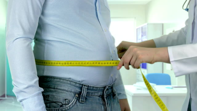 measuring overweight - 4k resolution - sovrappeso video stock e b–roll