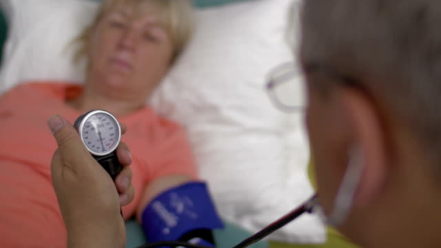 Measuring womans blood pressure video
