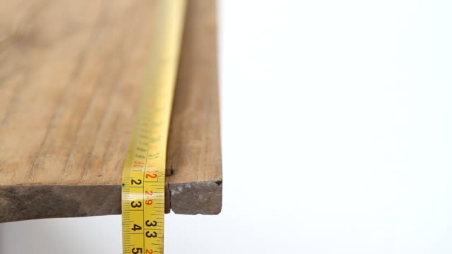 Measuring wood with measure tape video