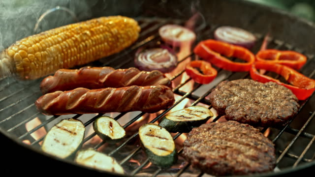 SLO MO TU Meat and vegetables on the grill video
