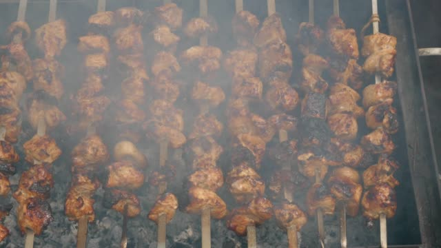 Meat grilled over charcoal. Picnic theme Meat grilled over charcoal. Picnic theme skewer stock videos & royalty-free footage
