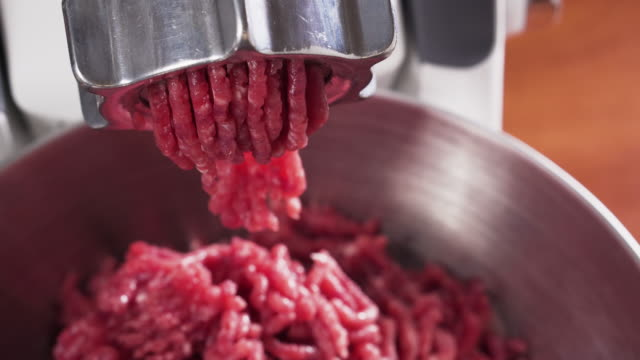 meat grinder, grinds the meat into minced meat. minced beef. - grindare video stock e b–roll