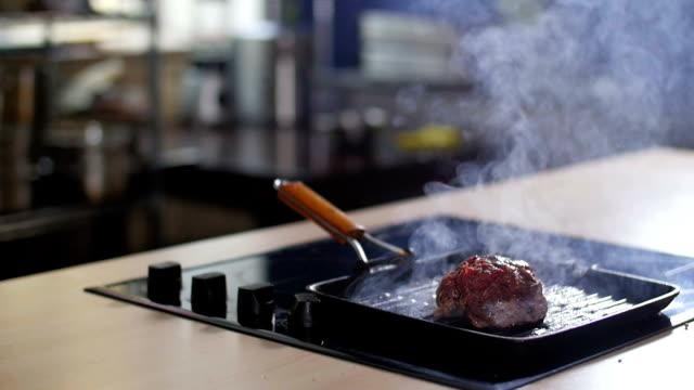 Meat is fried in a pan video