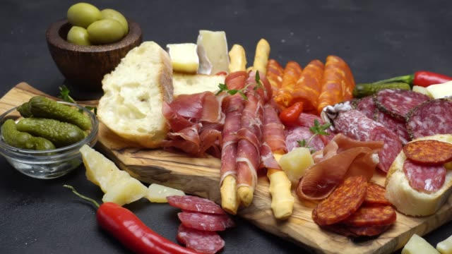 meat plate - salami and chorizo sausage close up on a wood board video