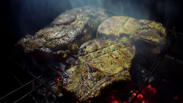 Meat roasted on fire barbecue on the grill. Street food, close up. video