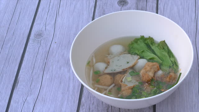 Meatballs with Noodle Soup on table