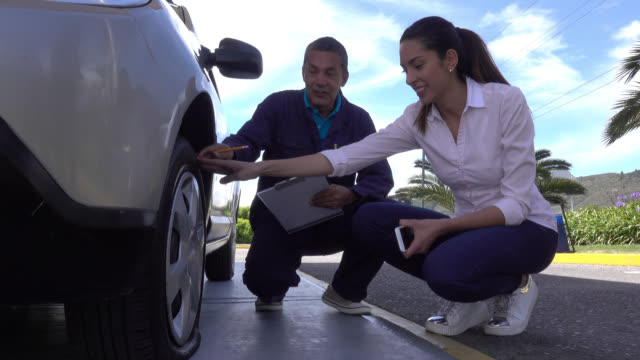 Mechanic assistance arriving to help a woman with a flat tire video