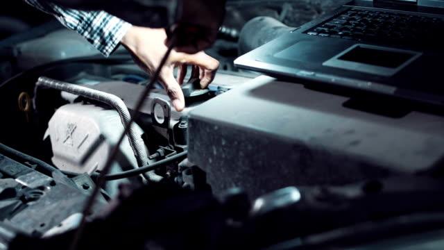 Mechanic doing a diagnostic on a car engine video