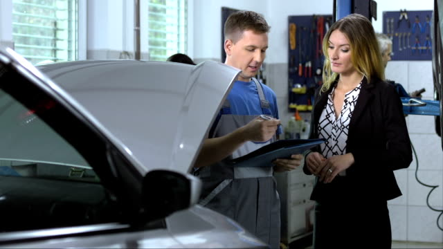 Mechanic Explaining Repairs For Car Repair video