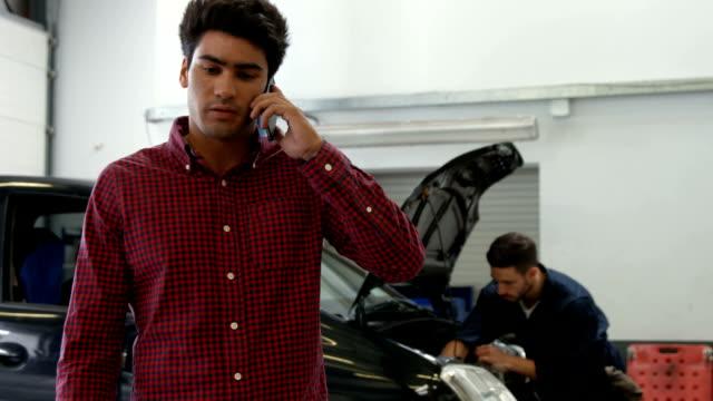 Mechanic in a phone call video