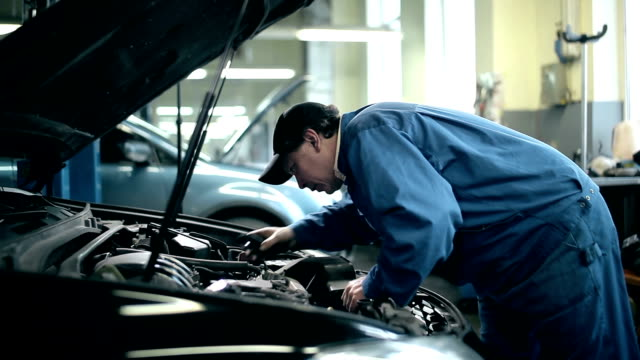 Mechanic inspecting the car engine video