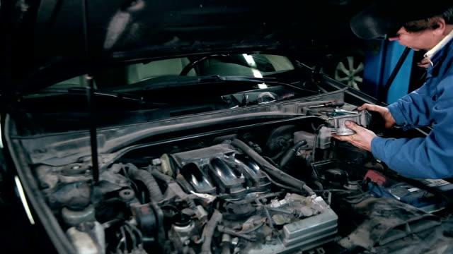 Mechanic inspecting the throttle body video