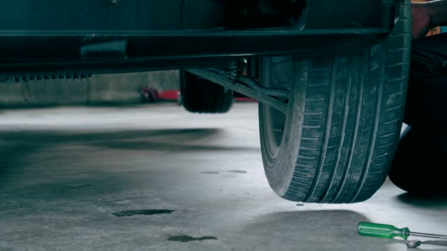 Mechanic men with Tire changing at car service stock video video