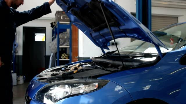 Mechanic overhauling an engine video