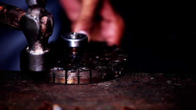 Mechanic repairing ceiling fan motor video