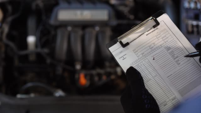 Mechanic repairman inspecting car Mechanic repairman inspecting car closeup quality control stock videos & royalty-free footage