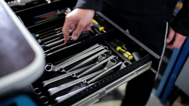 Mechanic takes screwdriver from tool box video