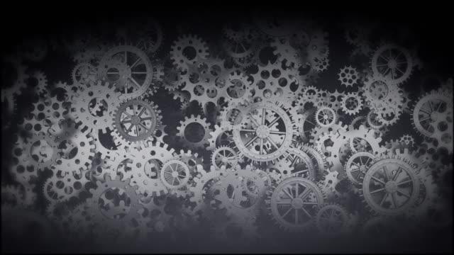 vidéos et rushes de mécanique et technologie fond, avec rotation des engrenages, dans un vieux style de film - rouage mécanisme