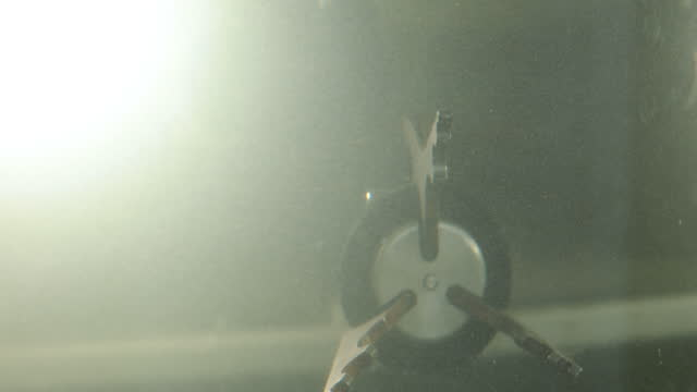 Mechanical arm operates on deep sea submersible in ocean.
