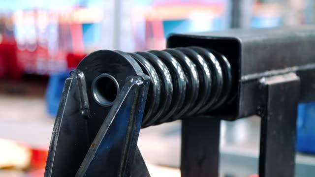 vídeos de stock e filmes b-roll de mechanical processing of spring for shock absorber on machine - esponja