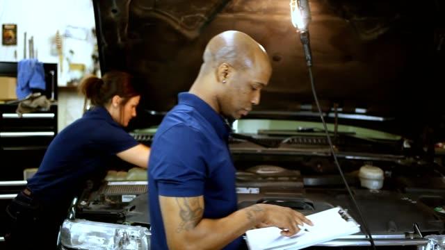 Mechanics working in repair shop video