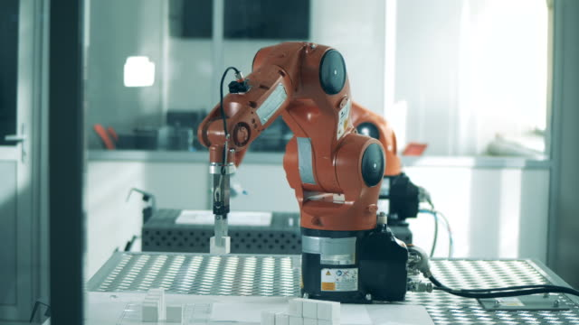 Mechanized robot is relocating small objects Mechanized robot is relocating small objects. 4K arm stock videos & royalty-free footage