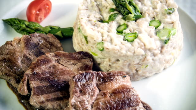 Medallions of pork tenderloin served with asparagus risotto video