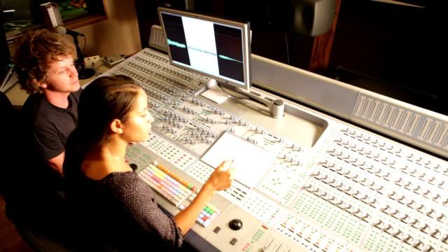 media: audio engineers at mixing desk video