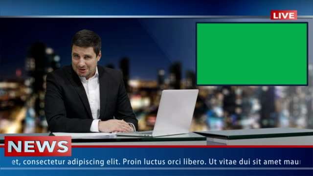 media broadcaster is sitting at a table and talking. display with green screen. news show mock-up. - conferenza stampa video stock e b–roll