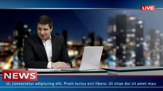 media broadcaster is sitting at a table and talking. news show mock-up. - servizi video stock e b–roll