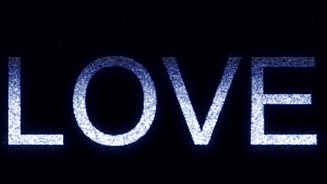 Media screen with glowing white and blue LOVE inscription, loopable motion background Media screen with glowing white and blue caption mottled stock videos & royalty-free footage
