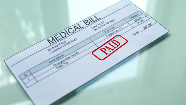 vídeos de stock e filmes b-roll de medical bill paid, hand stamping seal on document, payment for services, tariff - benefits