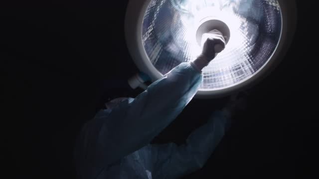 Medical brother turning surgical lamp First person shot of medical assistant turning surgical lamp on patient operating stock videos & royalty-free footage