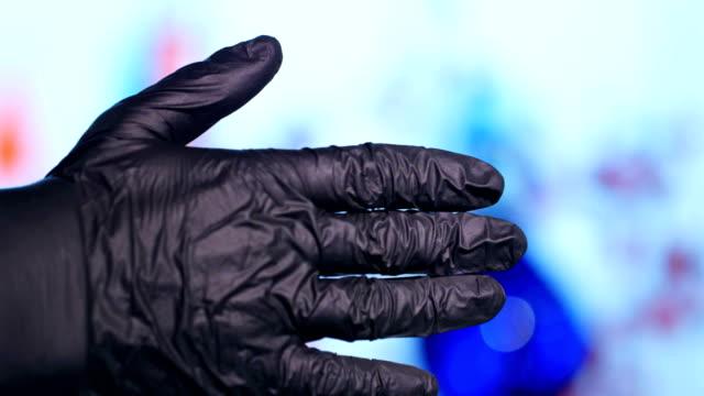 medical gloves hand punch coronavirus bacteria - guanto indumento sportivo protettivo video stock e b–roll