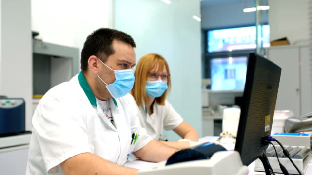 medical lab employees at work. - covid ospedale video stock e b–roll