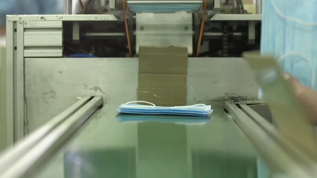 Medical mask on conveyor belt in the workshop video