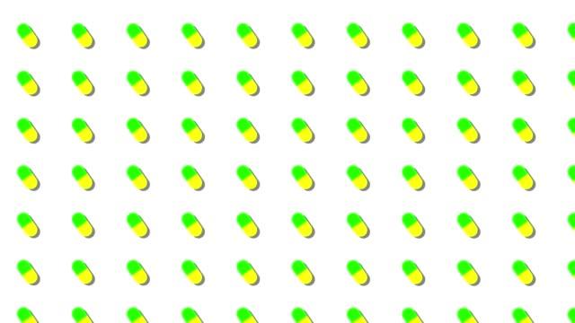 receptbelagda piller bakgrund loop grön och gul - loopad bild bildbanksvideor och videomaterial från bakom kulisserna