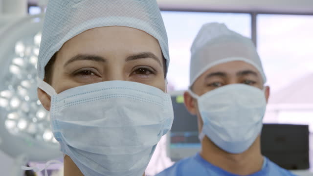 medical professionals working at a hospital - mask surgery video stock e b–roll
