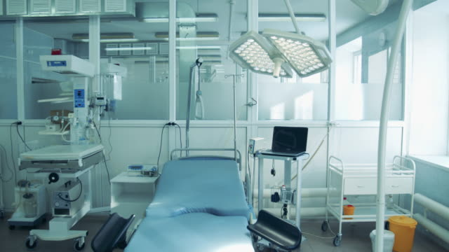 Medical room with modern machines and bed.