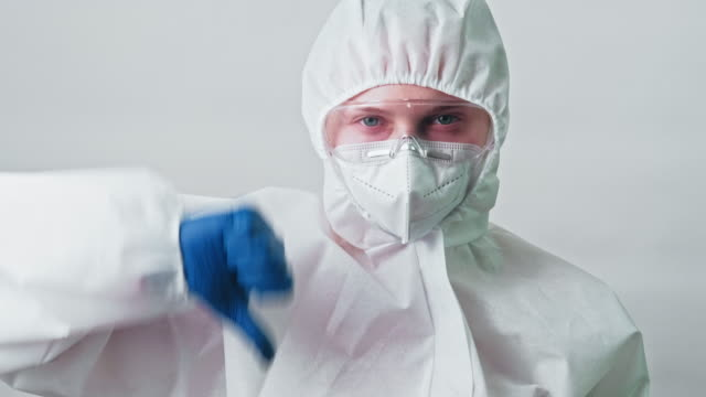 medical scientist ppe googles mask thumb down - google filmów i materiałów b-roll