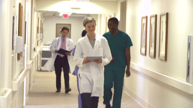 Medical Staff Along Hospital Corridor video