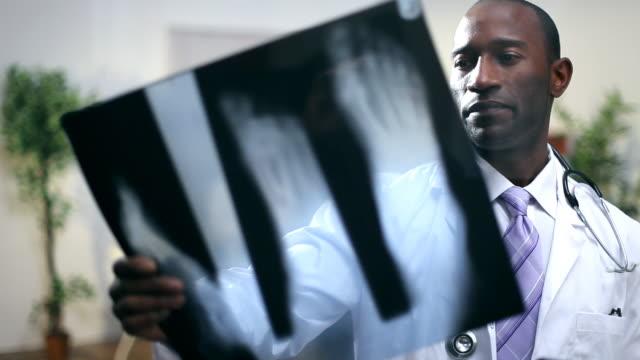 Medical staff examine xray video
