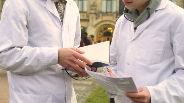 Medical students at campus background video
