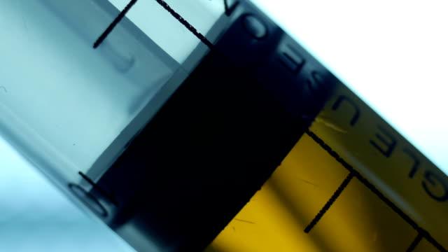 medical syringe vaccine drug - doping stok videoları ve detay görüntü çekimi