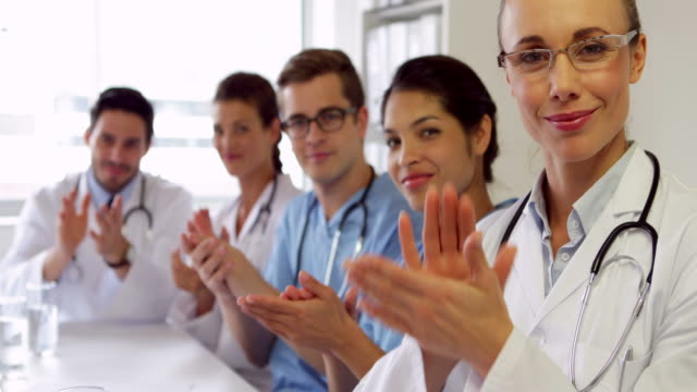 Medical team clapping at camera video